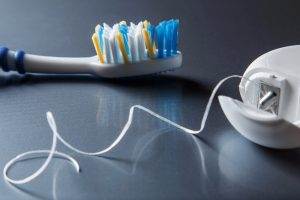 Toothbrush and dental floss in Newnan GA