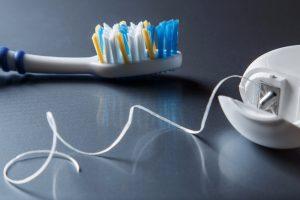 Toothbrush and dental floss in Newnan GA