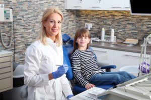 Dentist and young girl