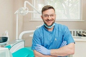 Portrait of friendly dentist in the dental office
